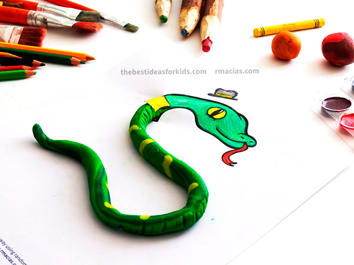 Art supplies and Snake from Complete The Animals Game - Fun idea for an Arts and Crafts game where kids exercise their creativity and problem-solving skills by coming up with different ways to complete the bodies of different animals. Free PDF has the base drawings for printable for the following animals: Lion, Bird, Cat, Turtle, Snake, Fish, Butterfly and Sheep.