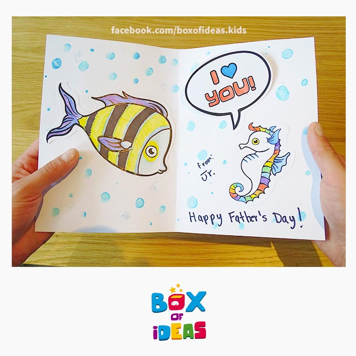 daddy-fish-and-seahorse-illustrated-guess-what-bilingual-card-for-Inclusive-Modern-DIY-Fathers-Day-Gift-by-box-of-ideas
