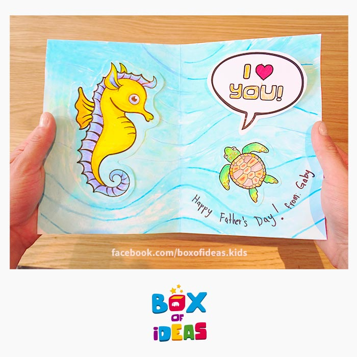 daddy-seahorse-and-baby-turtle-daugther-illustrated-guess-what-bilingual-card-for-Inclusive-Modern-DIY-Fathers-Day-Gift-by-box-of-ideas