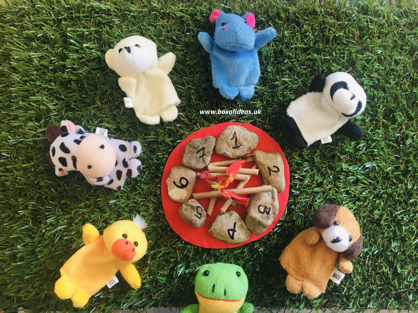 Soft animals around a campfire with numbers for Preschool