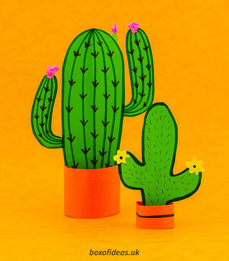 Pair Resting 3-d cactus crafts next to the book 60 easy paper projects #papercraft #kidscraft #craftsforkids #cactus #easycrafts #boxofideasof simple 3-d cactus craft with flowers in an orange pot #papercraft #kidscraft #craftsforkids #cactus #easycrafts #boxofideas