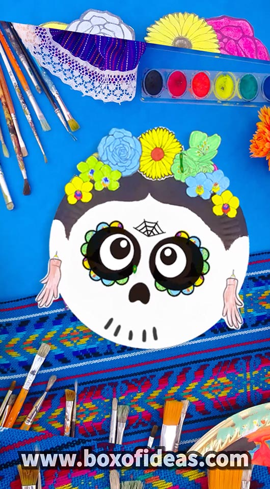 Paper Plate Frida Kahlo skull craft with colorful paper flowers