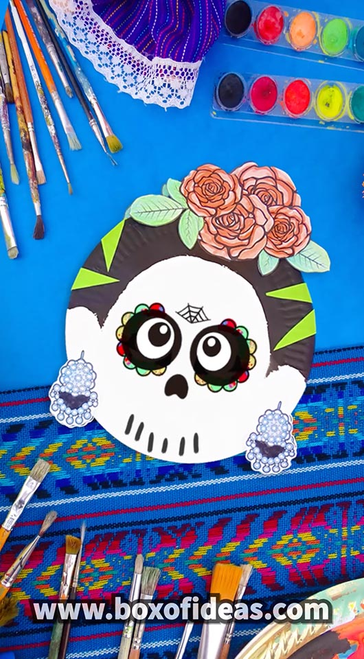 Paper Plate Frida Kahlo skull craft with peachy paper roses