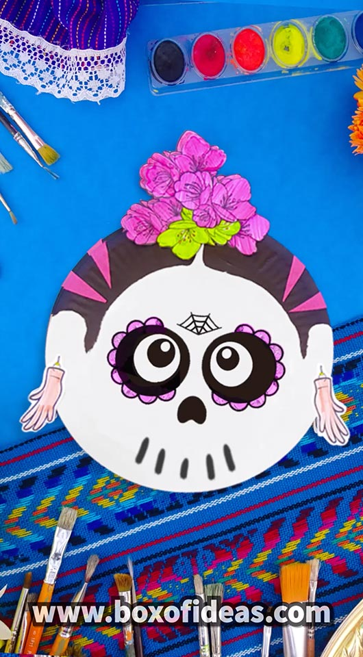 Paper Plate Frida Kahlo skull craft with pink paper flowers
